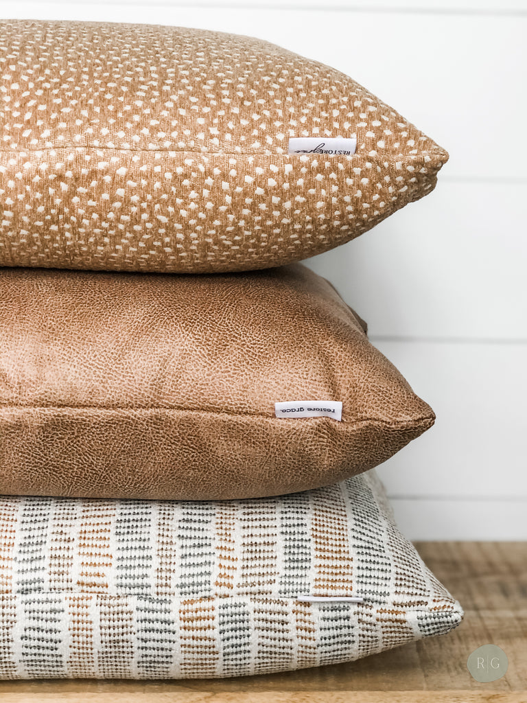 Textured and patterned cushions stacked