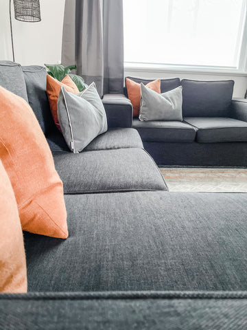 sofa styled with outback and slate coloured cushions