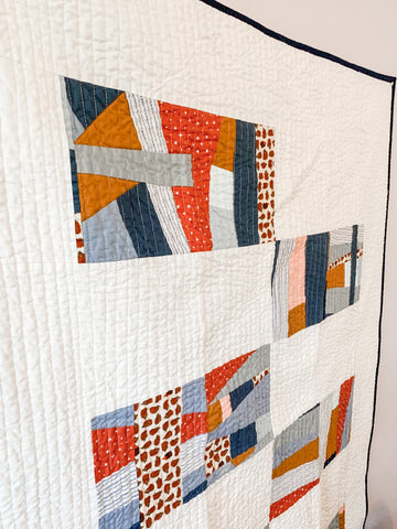 Blue, Gray, and Orange Hedgehog Crib Quilt - Quilts a la Mode