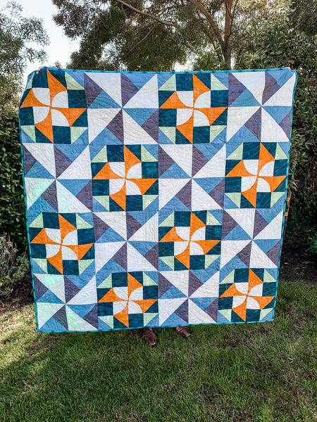 Blue, Gray, Yellow Electric Pinwheel Quilt - Quilts a la Mode