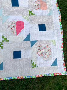 Scrappy Heart Baby Blanket with handstitching details - Quilts a la Mode