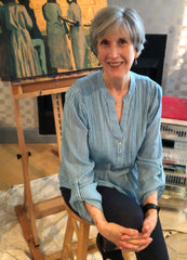 Laura Hunt with painting on easel in background