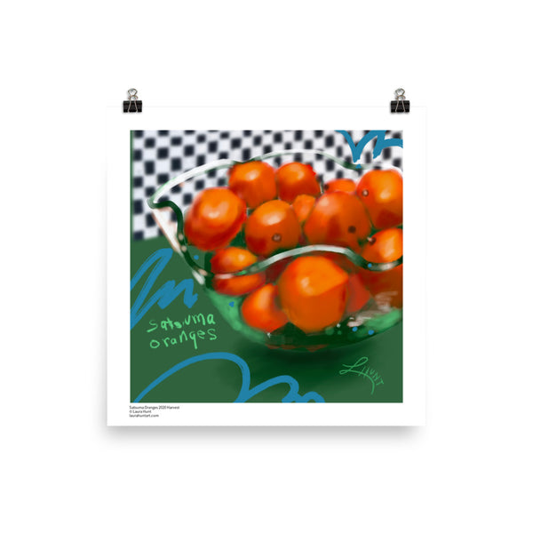 Satsuma oranges in a fluted glass bowl on a green table against a checkered background. By Laura Hunt