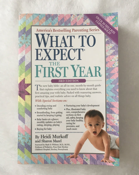What to Expect the First Year by Heidi Murkoff (used paperback)