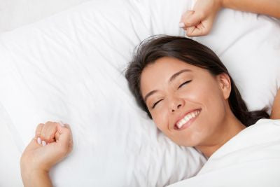 relaxed woman feeling refreshed after sleeping well
