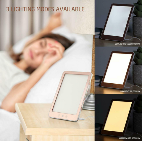 woman in bed near Mumba sunlight lamp and showing 3 different settings