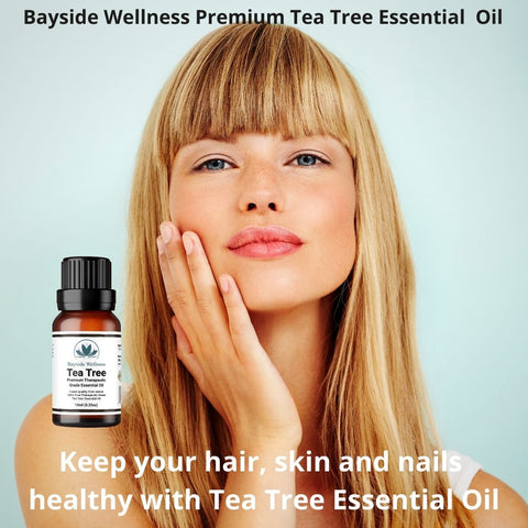 Woman caring for her skin, hair and nails with Bayside Wellness Premium Tea Tree Essential Oil