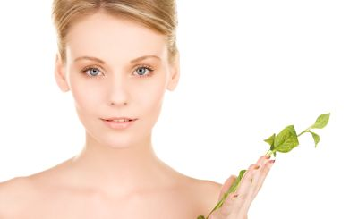 woman holding plant essential oil beautiful skin