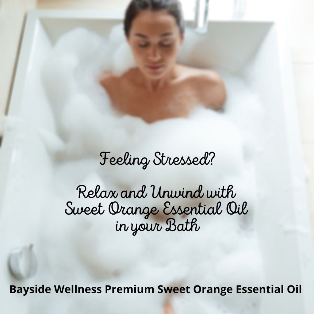Woman relaxing in bath with Bayside Wellness Premium Sweet Orange Essential Oil