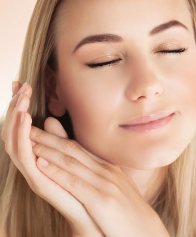 woman enjoying jojoba  moisturizing