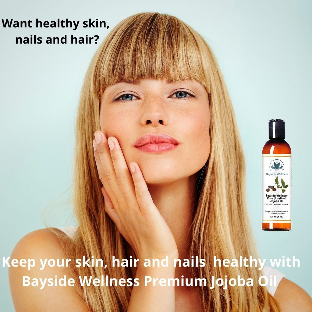 Woman moisturizing skin with Bayside Wellness Premium Jojoba Oil
