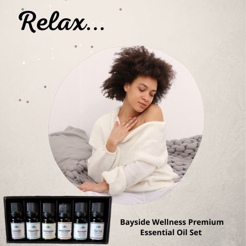 woman relaxing with set of 6  Bayside Wellness Premium  Essential Oils