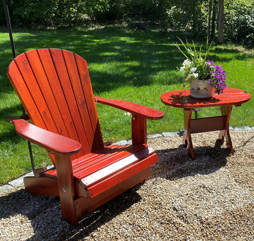 Knotted pine Adirondack chair outside