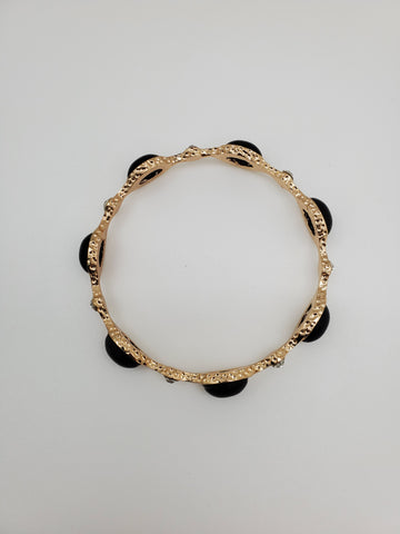 Golden bracelet with diamonds like stones and black faux stone