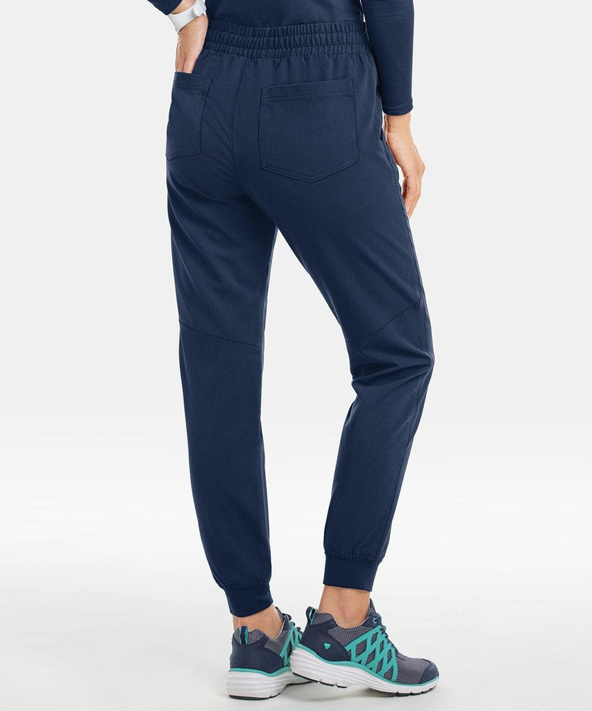 A woman wearing Keswi's Ventura jogger style in navy
