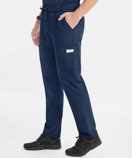 A man poses in the most comfortable scrubs.