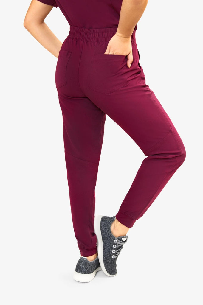 person in red stretchy scrub pants from Keswi