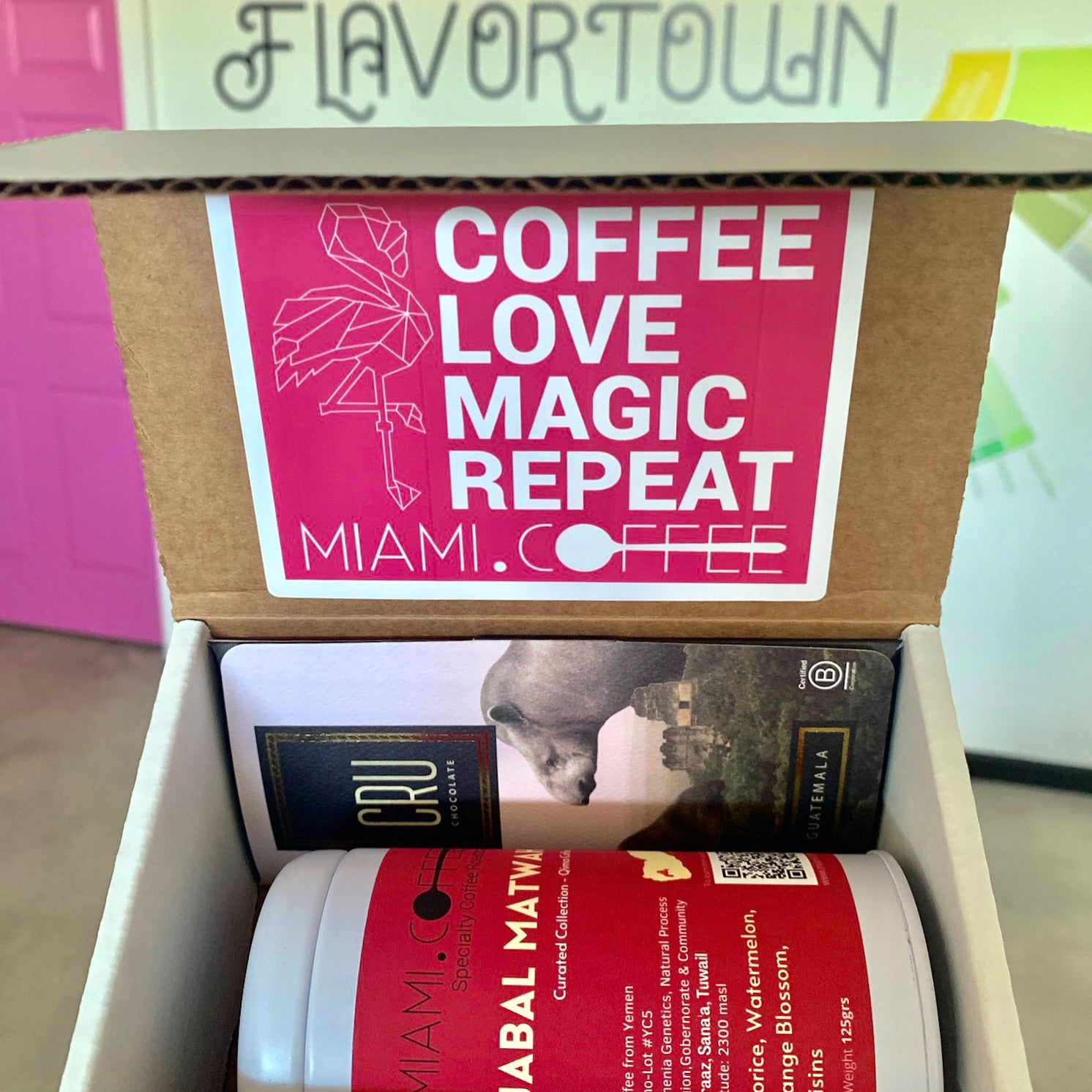 Box containing 125g can of Jabal Matwah Yemenia coffee from Miami.Coffee and single origin specialty chocolate bar. #CoffeeLoveMagicRepeat