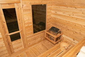 Inside the Dundalk Leisurecraft Canadian Timber Luna Sauna viewing the 6KW heater, front door, front window, water bucket and ladle