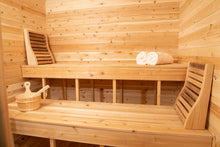 Load image into Gallery viewer, Inside the Dundalk Leisurecraft Canadian Timber Luna Sauna, viewing the top and bottom benches, backrests, water bucket with ladle, and towels