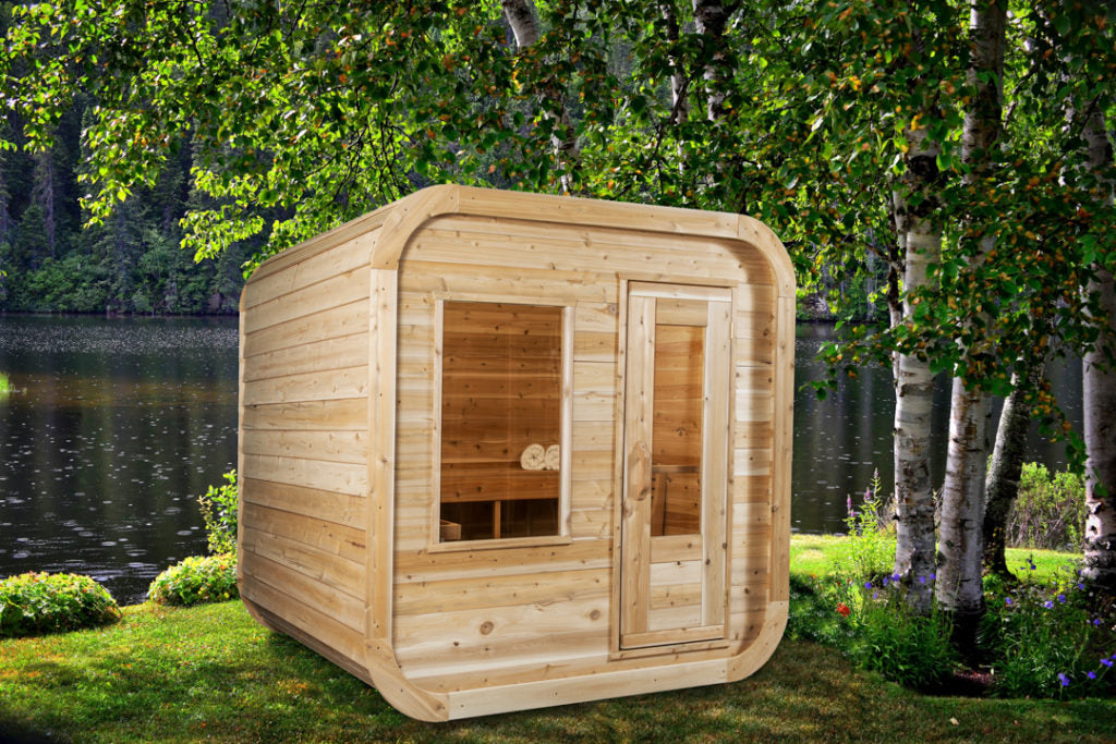 Dundalk Leisurecraft Canadian Timber Luna Sauna sitting outside facing right in a gorgeous backyard with a pond in the back