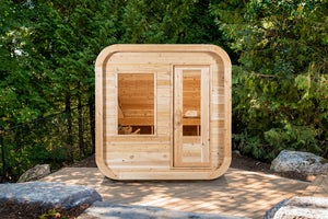 Dundalk Leisurecraft Canadian Timber Luna Sauna sitting outside facing front in a gorgeous backyard