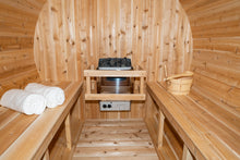 Load image into Gallery viewer, Inside the Dundalk Leisurecraft Canadian Timber Harmony Barrel Sauna viewing 6KW heater, towels, water bucket and ladle