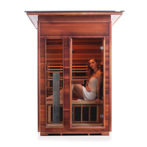 Enlighten Sauna Rustic 2 Person Slope Roof with woman sitting inside, sauna facing front