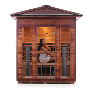 Enlighten Sauna Rustic 4 Person Peak Roof front facing view with woman inside and white background