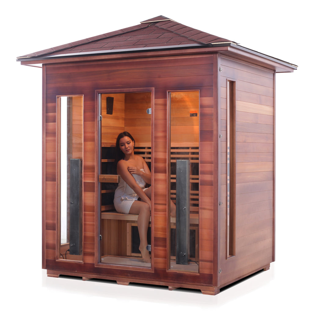Enlighten Sauna Rustic 4 Person Peak Roof facing left with woman inside, white background
