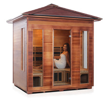 Load image into Gallery viewer, Enlighten Sauna Rustic 5 Person Peak Roof right facing view with woman inside