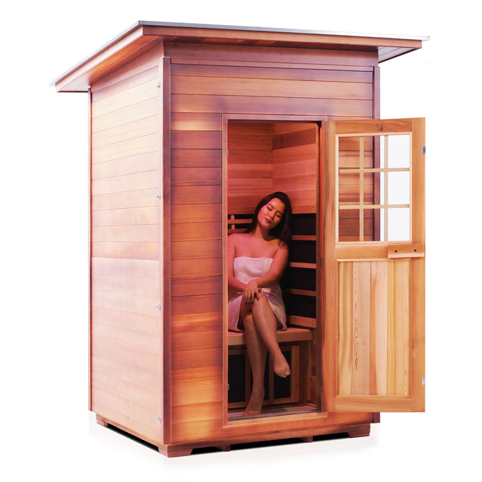Enlighten Sauna Sierra 2 Person Slope Roof with woman inside facing right in a white background
