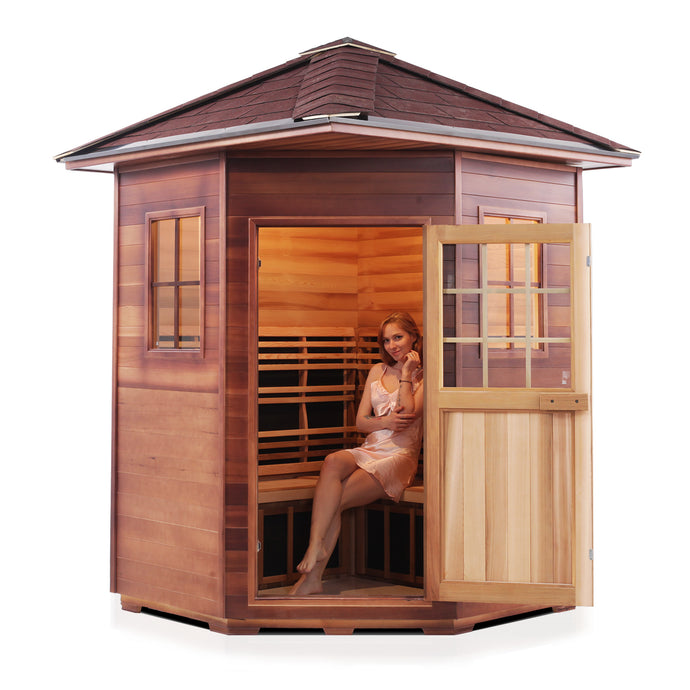 Enlighten Sauna Sierra 4 Person Corner Sauna with Peak Roof, woman inside with the door open