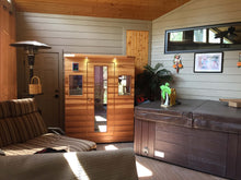 Load image into Gallery viewer, Health Mate - Enrich III Infrared Sauna next to jacuzzi in a gorgeous lounge room against the wall