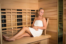 Load image into Gallery viewer, Health Mate - Enrich III Infrared Sauna inside view of woman laying against backrest