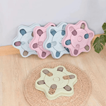Five Dog Puzzle Feeder in star shape, two are in pink, two are in blue and one in green. Each star feeder has 6 compartments where treats can be hid.