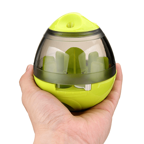 The food ball dispenser hold in a human hand to show its actual size