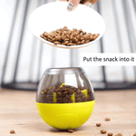 Food dog treats are added to the ball dispenser opened