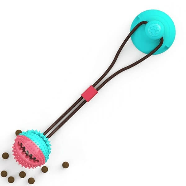 Full view of the Tug Ball composed of suction cup, rope and ball with dog treats inside