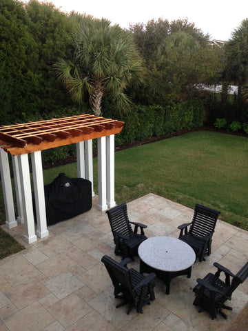 pergola with Big Green Egg cooking island and fire table set