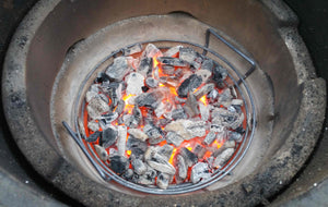Kick Ash basket with burning charcoal