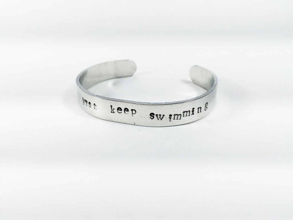 """Just Keep Swimming""  handmade aluminum bracelet"
