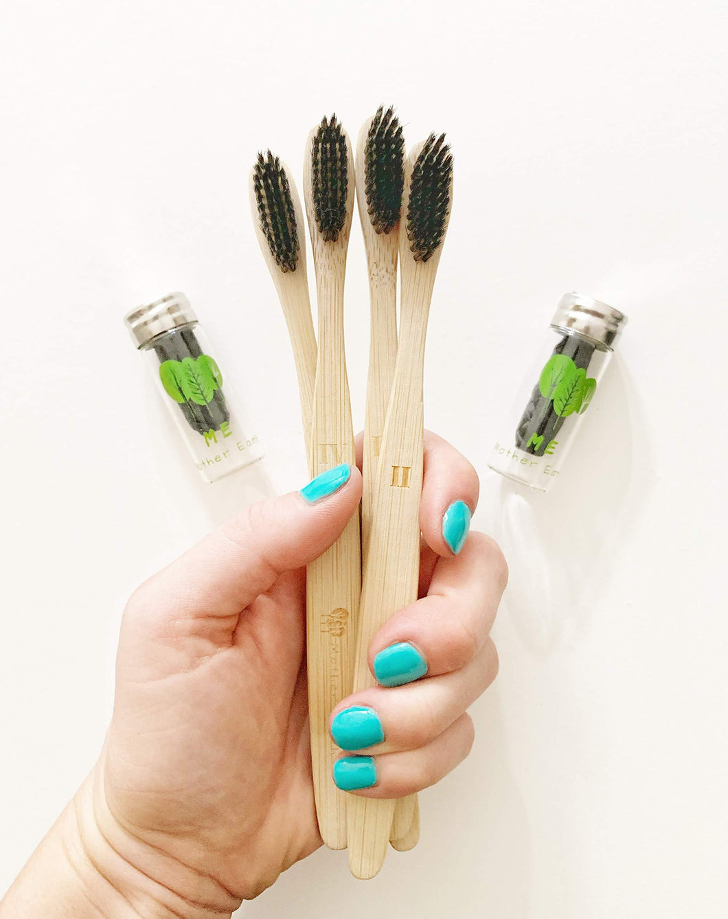 Plastic-free bamboo toothbrushes and floss.