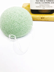 Biodegradable exfoliating sponge in green tea.