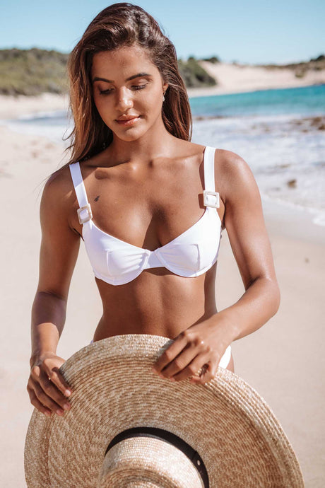 Sustainable women's white bikini top. Made from recycled nylon.
