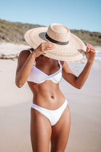Women's white high-waisted bikini bottoms. Made from sustainable fabric of recycled nylon.