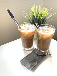 Two reusable metal straws with silicone tips.