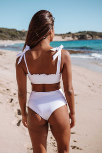 Eco-friendly women's white bathing suit top. Made from recycled ocean and landfill nylon waste.