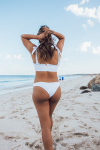 Sustainable women's white high-waisted swim bottoms. Made from recycled nylon.