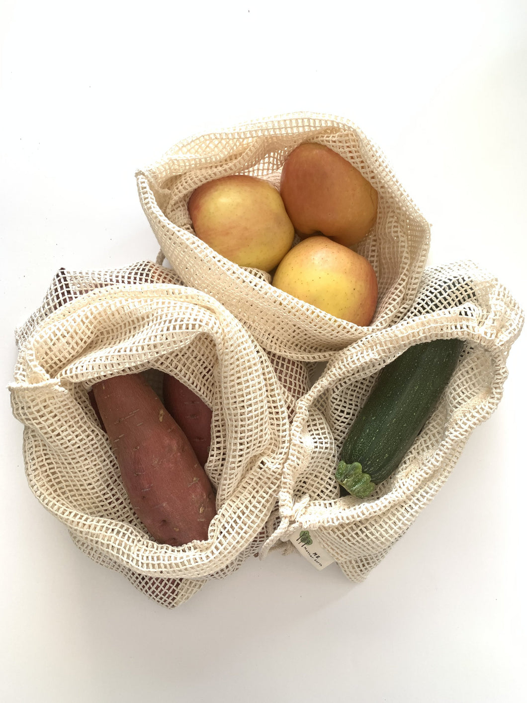 Three reusable produce bags in 100% cotton mesh.